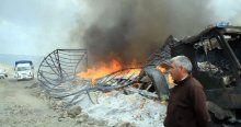 Teröristlerin yaktığı araçlar hurdaya döndü